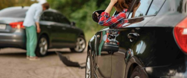 male-female-drivers-after-car-accident-road-min