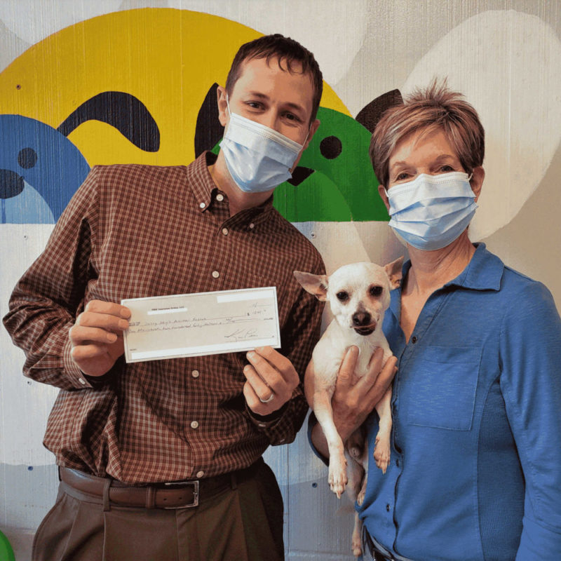 Ryan Stueber and Kim Peters from PNW Insurance Group dropping off donation check to Sunny Skys Animal Rescue